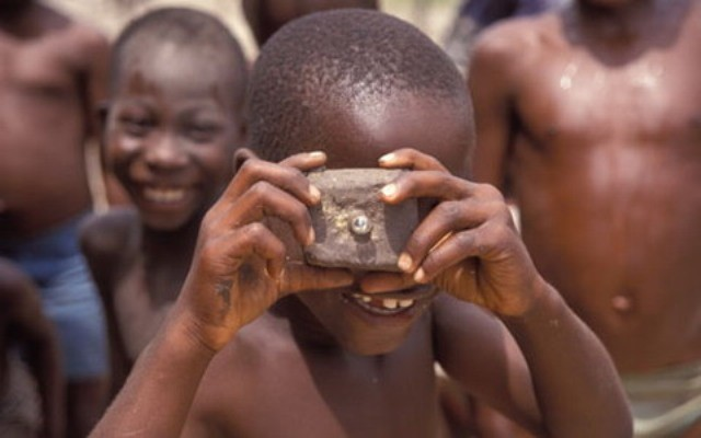 Niger poor boy mimicing the photographer